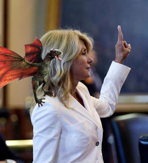 An image of Senator Wendy Davis, with a dragon from Game of Thrones photoshopped onto her shoulder.  This image became popular as the time ticked past midnight in Texas, comparing Davis to the character of Dany in Game of Thrones.